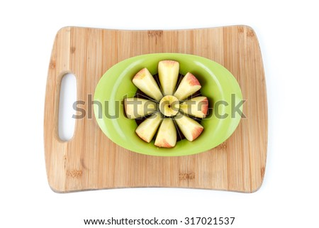 Isolated Overhead View of Apple being Sliced on a Bamboo Cutting Board - stock photo