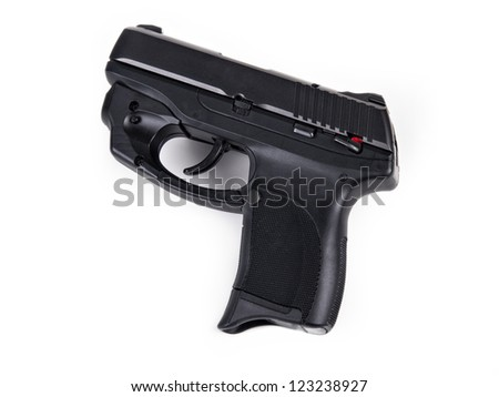 Isolated photo of a 9mm handgun with Laser - stock photo