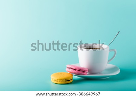 Isolated photo of coffee with macaroons - stock photo