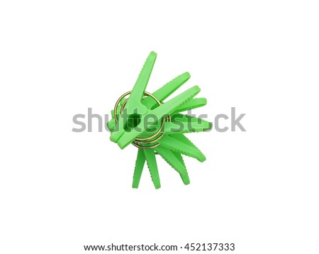 Isolated photo of light green clothespin with white background - stock photo