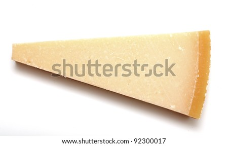 isolated piece of parmesan cheese, top view - stock photo