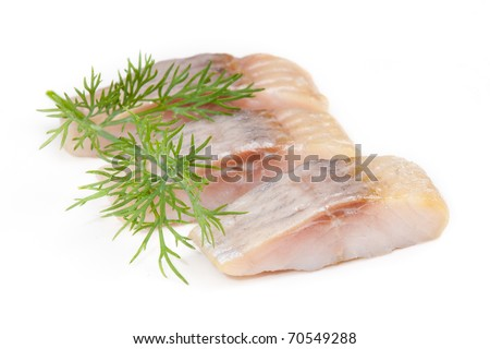 isolated pieces of salt herring fish wiht dill - stock photo