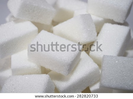 isolated pile of sugar cubes close up view in sweet nutrition , unhealthy eating and diet concept - stock photo
