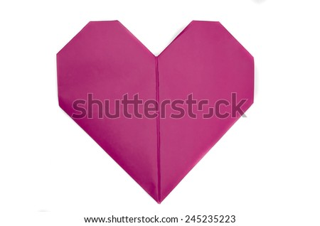 Isolated pink paper origami heart for Valentine's Day symbolizing love - stock photo
