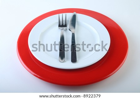 isolated plate with fork and knife - stock photo