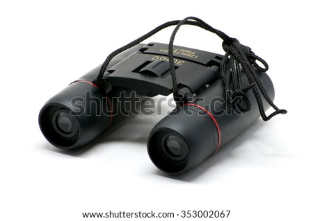 Isolated pocket small black binoculars with cord - stock photo