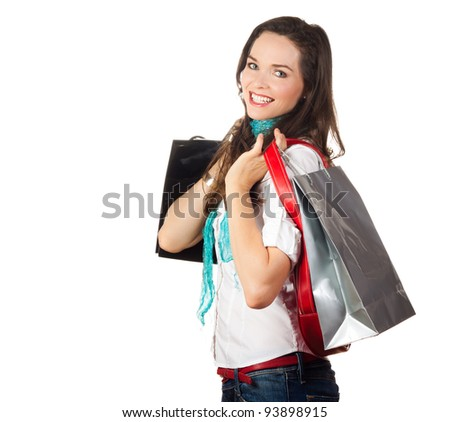 Isolated portrait of a beautiful young woman shopping - stock photo