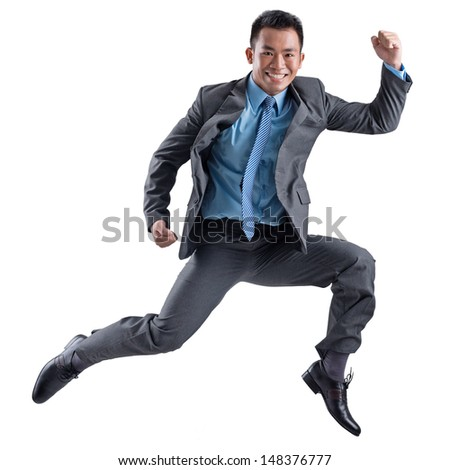 Isolated portrait of a cheerful businessman dancing over a white background - stock photo