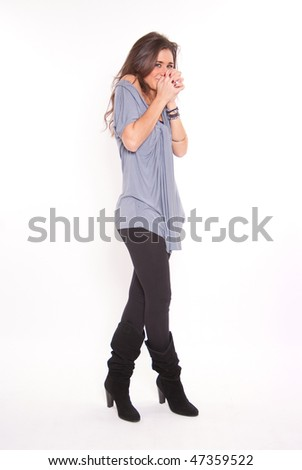 Isolated portrait of a extremely pleased young brunette - stock photo