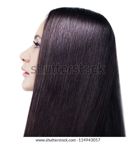 Isolated portrait of a young long-haired brunette in a profile - stock photo