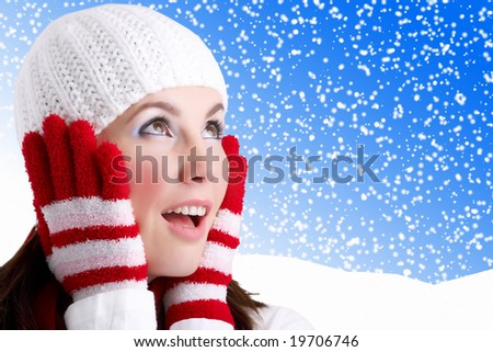 Isolated Portrait of a young woman looking surprised in a winter background - stock photo