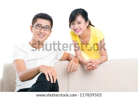 Isolated portrait of two friends or siblings smiling at camera - stock photo