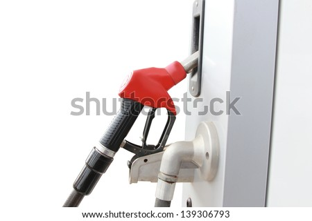 isolated red fuel dispenser at the gas station - stock photo
