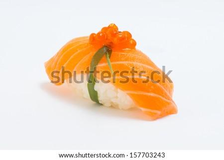 Isolated salmon sushi nigiri with salmon roe - stock photo