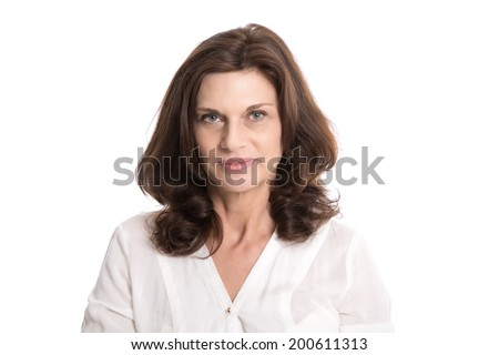 Isolated serious and doubtful older woman in middle age. - stock photo