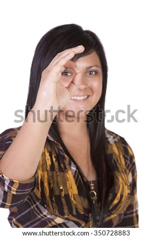 Isolated Shot of a Beautiful Girl Giving the OK Sign - stock photo