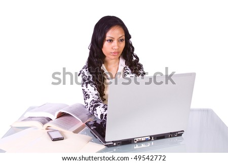 Isolated Shot of a Cute Woman Studying at her Desk - stock photo