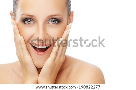 isolated shoulder level portrait of young woman with fresh and clean skin and manicured hands touching her face - stock photo