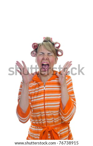 isolated shouting young pretty housewife with curlers - stock photo