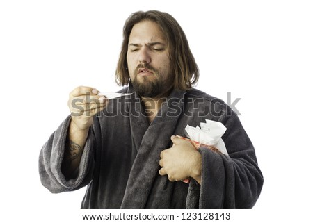isolated sick man bundled up in a robe taking his temperature - stock photo