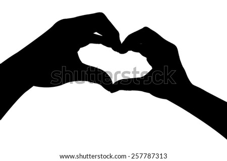 isolated silhouette hand In heart shape - stock photo