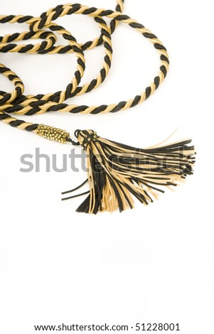 Isolated silk curtain tassel. - stock photo