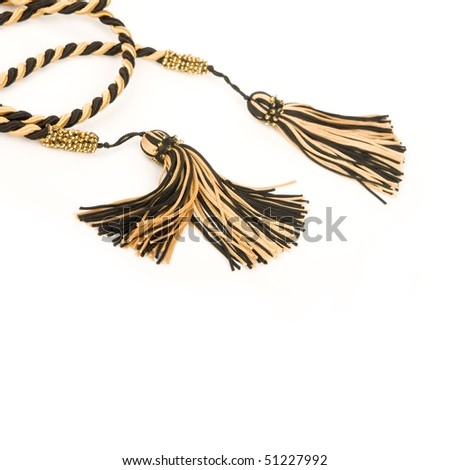 Isolated silk curtain tassels. - stock photo