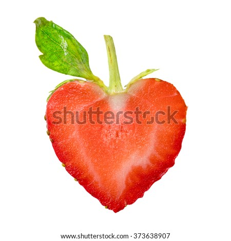 Isolated. Sliced strawberries in a heart shape  as a symbol of love.  - stock photo