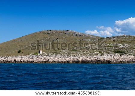 Isolated small houses at Adriatic sea by National Park Kornati in Croatia at Adriatic sea, Mediterranean, Europe - stock photo