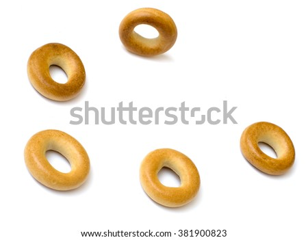 Isolated small rounds of dry bagels  - stock photo