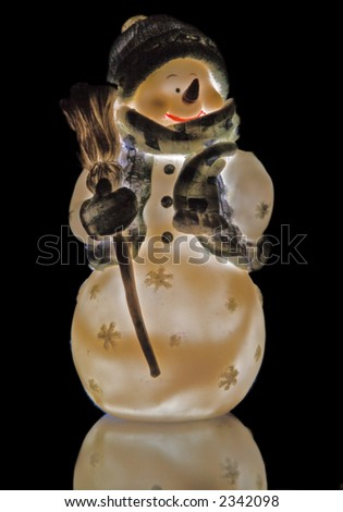 isolated snowman on black - stock photo