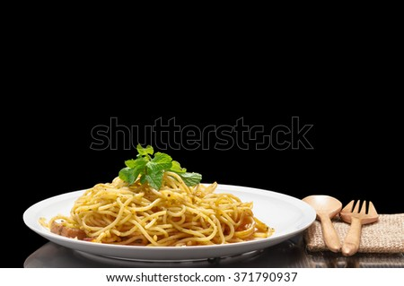 Isolated Spaghetti on black background with clipping path - stock photo