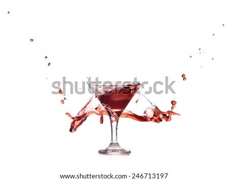 Isolated splash of red wine in glass - stock photo