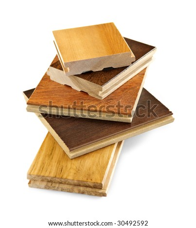 Isolated stacked prefinished hardwood flooring samples - stock photo