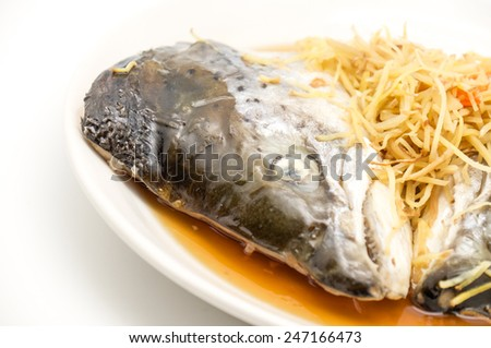 Isolated steamed salmon head with Japanese sweet soy sauce on white background - stock photo