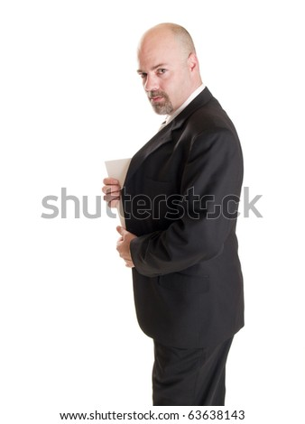 Isolated stock photo of a caucasian businessman looking at the camera while showing the corner of a secret document he has hidden in his coat. - stock photo
