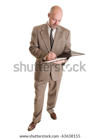 Isolated stock photo of a caucasian businessman writing on a notepad. - stock photo