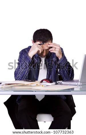 Isolated Stressed Businessman At His Desk Working - White Background - stock photo