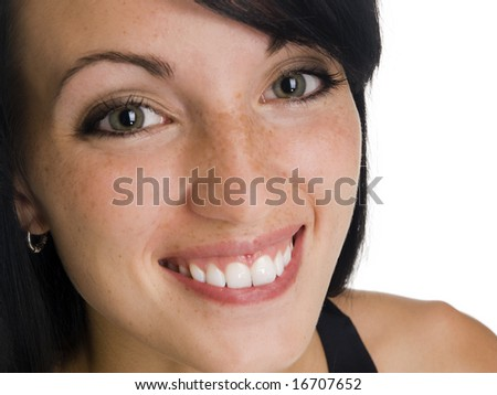 Isolated studio headshot of a businesswoman smiling while looking at the camera. - stock photo