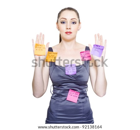 Isolated Studio Portrait Of An Admin Assistant Or PA Looking Stressed And Tired With Various Home And Office Duties Stuck To Body In A Multi Tasking Concept - stock photo