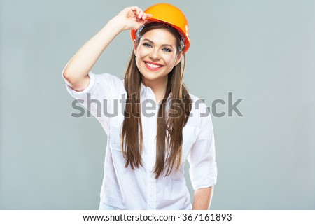 Isolated studio portrait of smiling woman manager of real estate. Business woman wearing protect helmet. - stock photo