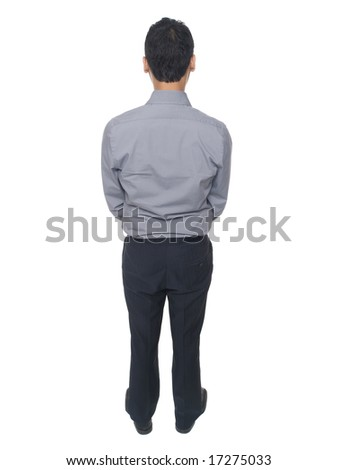 Isolated studio shot of a businessman standing patiently - stock photo