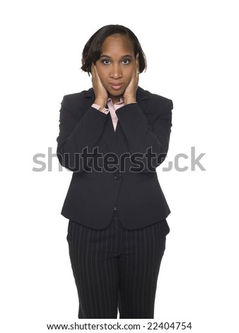 Isolated studio shot of a businesswoman in the Hear No Evil pose. - stock photo