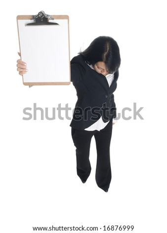 Isolated studio shot of a businesswoman presenting a blank clipboard while looking down. - stock photo