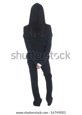Isolated studio shot of a businesswoman waiting with her hands clasped behind her back. - stock photo