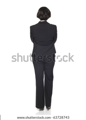 Isolated studio shot of a businesswoman with her arms crossed viewed from behind. - stock photo
