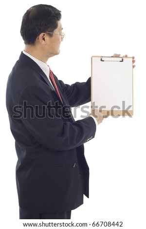 Isolated studio shot of an senior Asian American businessman presenting a blank clipboard. - stock photo