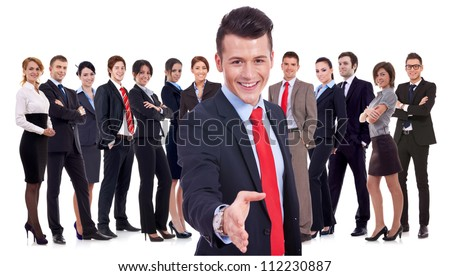 Isolated successful business team, focus on man with handshake gesture. young business man welcoming to the team - stock photo