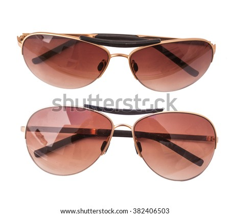 Isolated sun glasses on white background, top view, unisex (male and female glasses) - stock photo