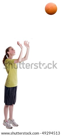 isolated teen age girl throwing a basketball - stock photo